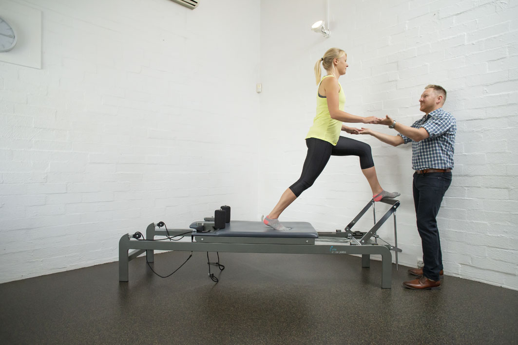 pregnancy clinical pilates on trapeze table with physio